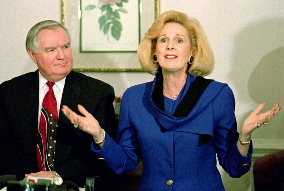 Word of Faith Fellowship church leader Jane Whaley talk to members of the media as husband Sam listens during a news conference in Spindale, N.C., Thursday, March 2, 1995. (AP Photo/Chuck Burton)