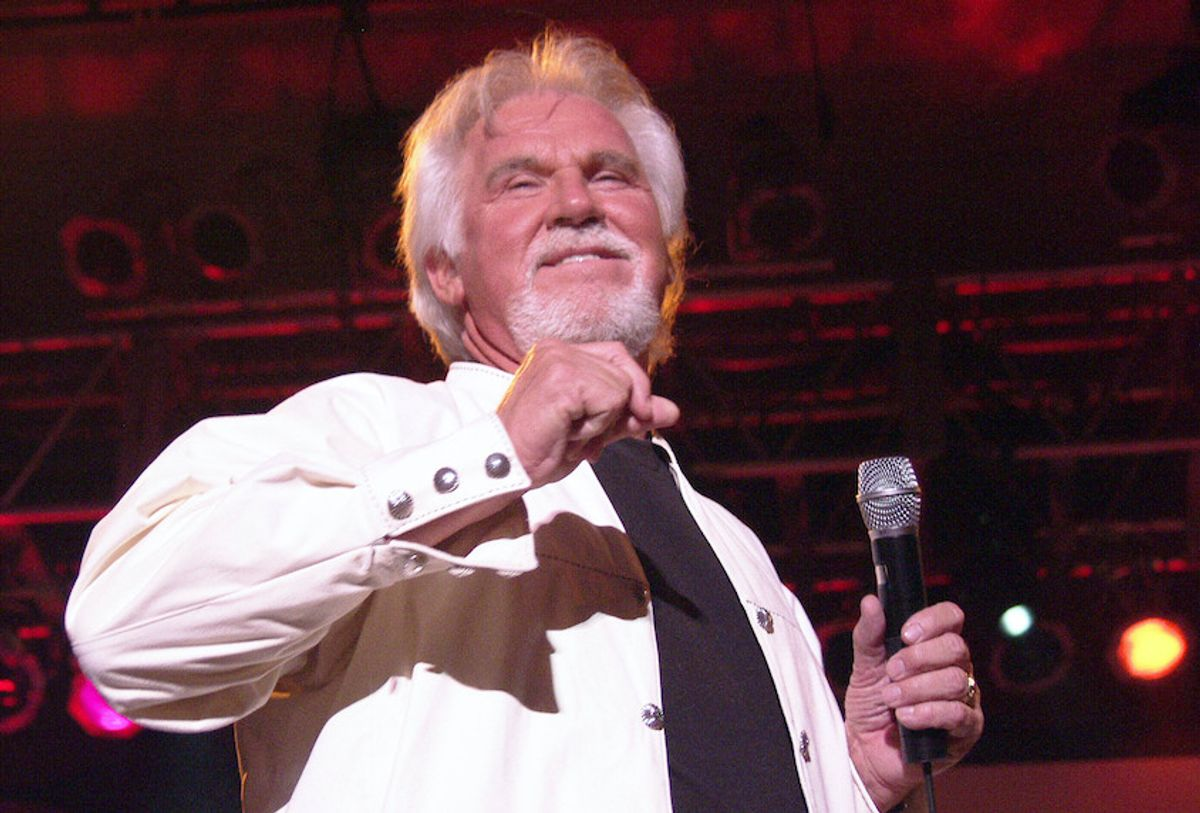 AP File Photo: Kenny Rogers Has Passed Away at 81. AUGUST 14: Kenny Rogers performs at Chastain Park Amphitheatre in Atlanta, Georgia on August 14, 2002.  (AP/ Chris McKay / MediaPunch /IPX)
