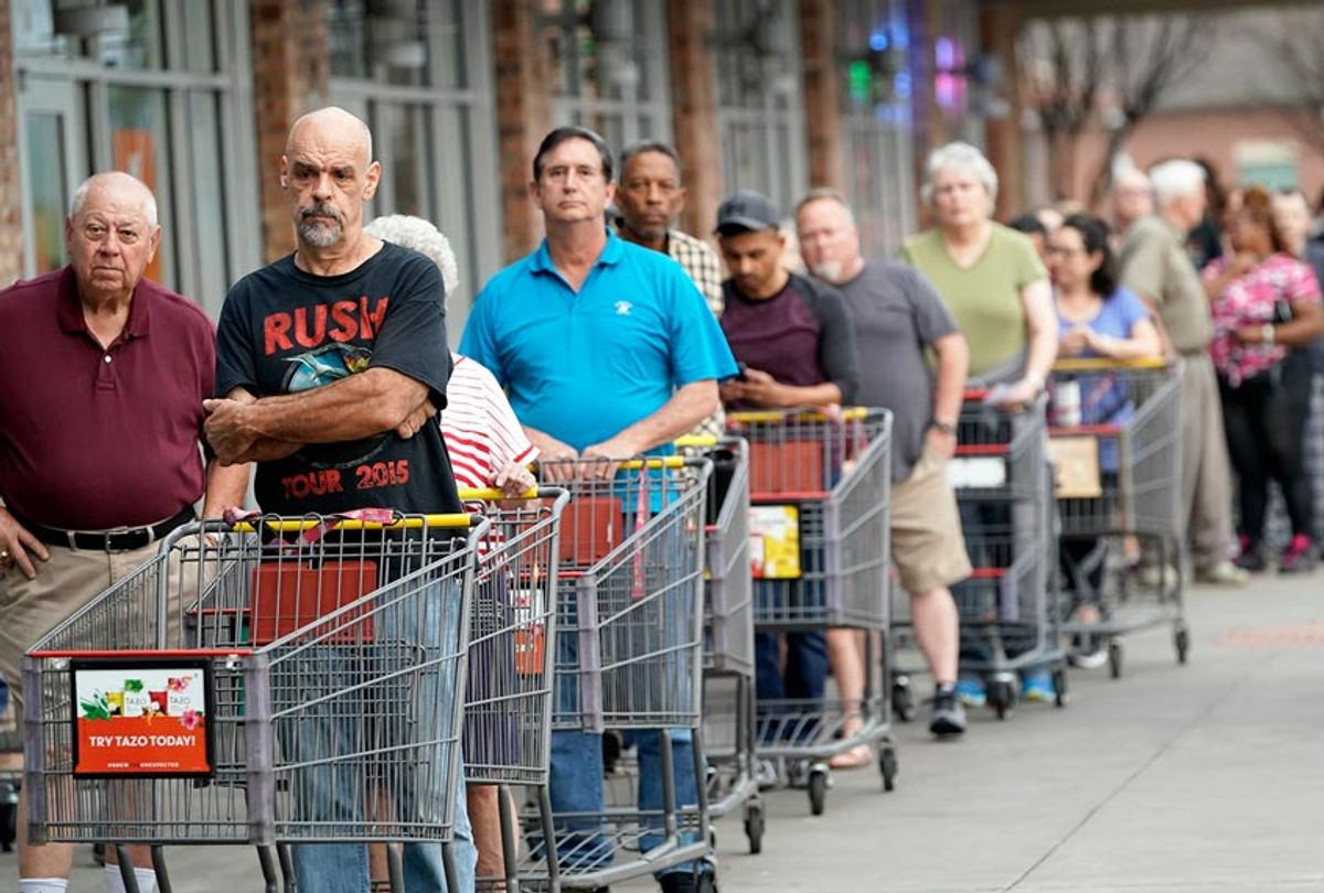 Some of the more than 150 people in line wait for an grocery store to open Tuesday, March 17, 2020 (AP Photo/David J. Phillip)