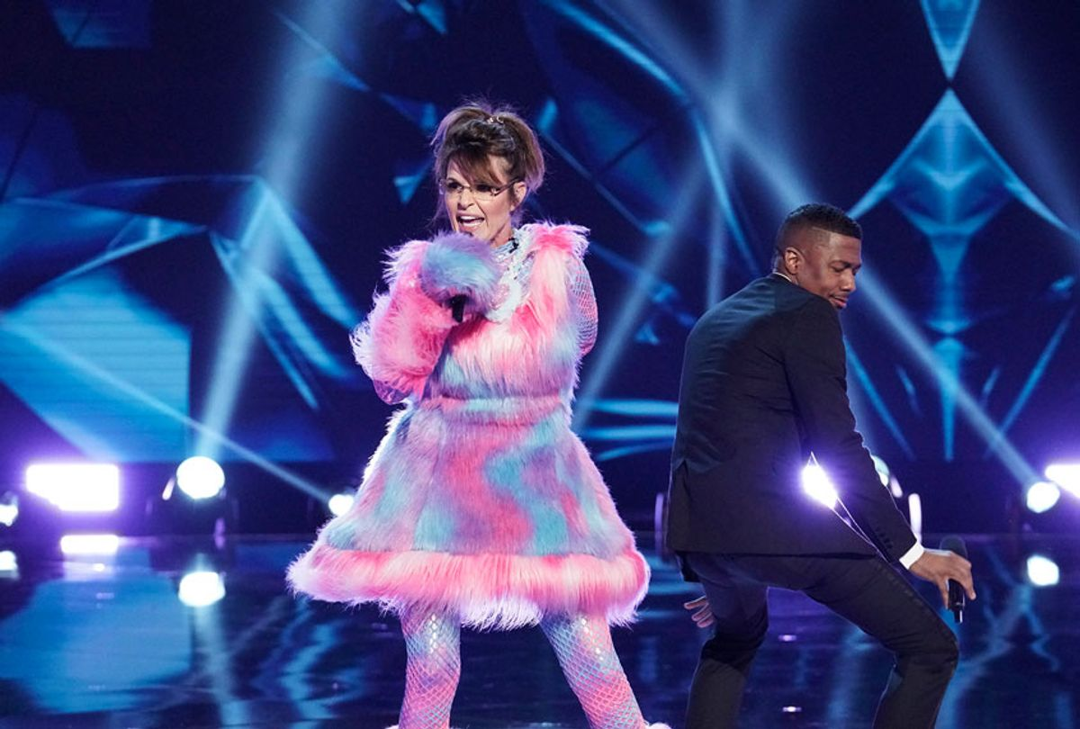 """THE MASKED SINGER: L-R: Sarah Palin and Host Nick Cannon in the """"Last But Not Least: Group C Kickoff!"""" episode of THE MASKED SINGER airing Wednesday, March 11 (8:00-9:01 PM ET/PT) on FOX. (Michael Becker / FOX. © FOX Media LLC.)"""