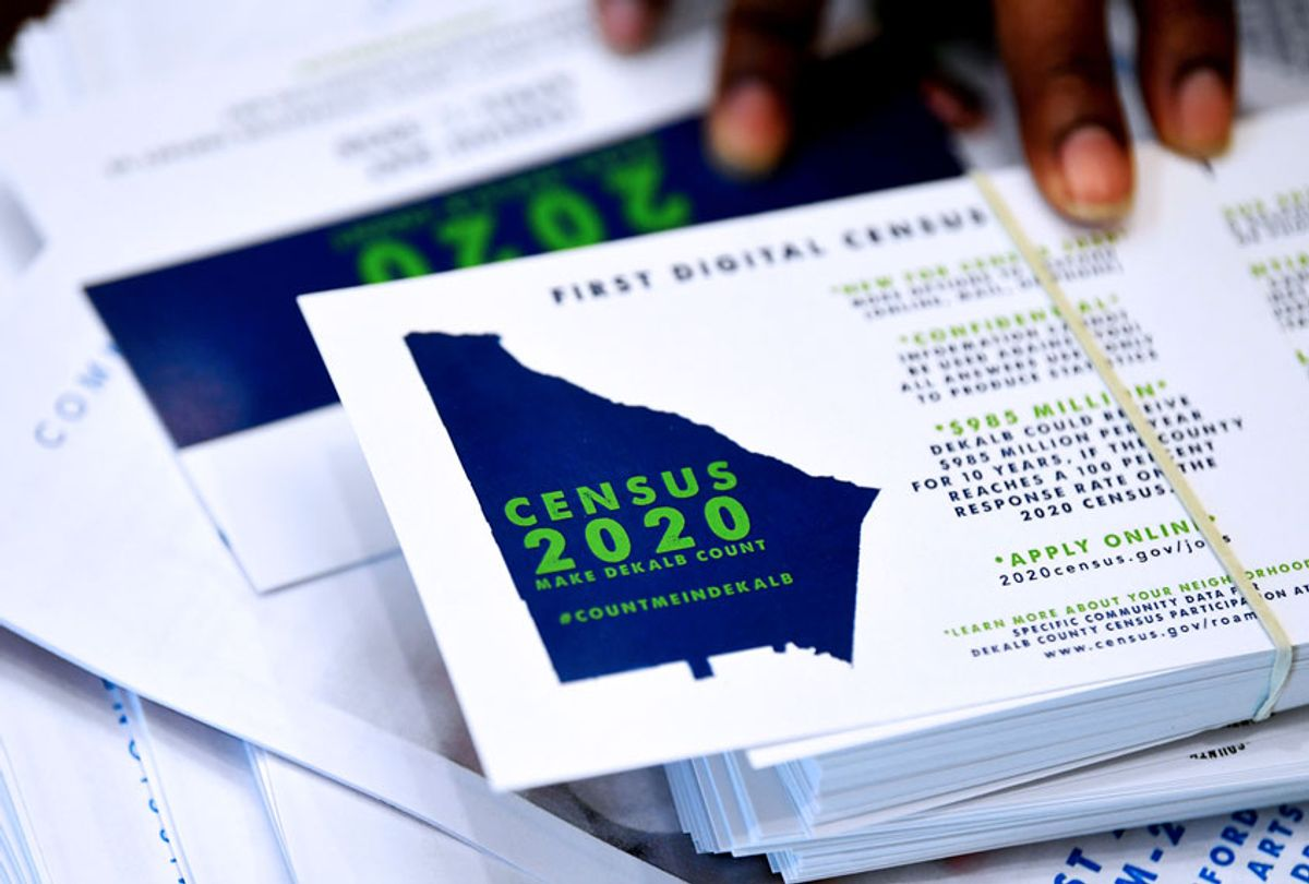 A worker gets ready to pass out instructions on how to fill out the 2020 census during a town hall meeting in Lithonia, Ga.  (AP Photo/John Amis)