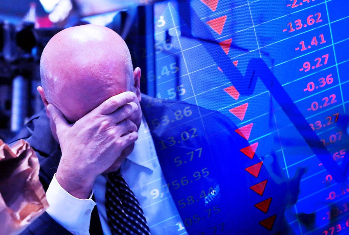 A trader has his head in his hand on the floor of the New York Stock Exchange | Stock market graph (AP Photo/Getty Images/Salon)