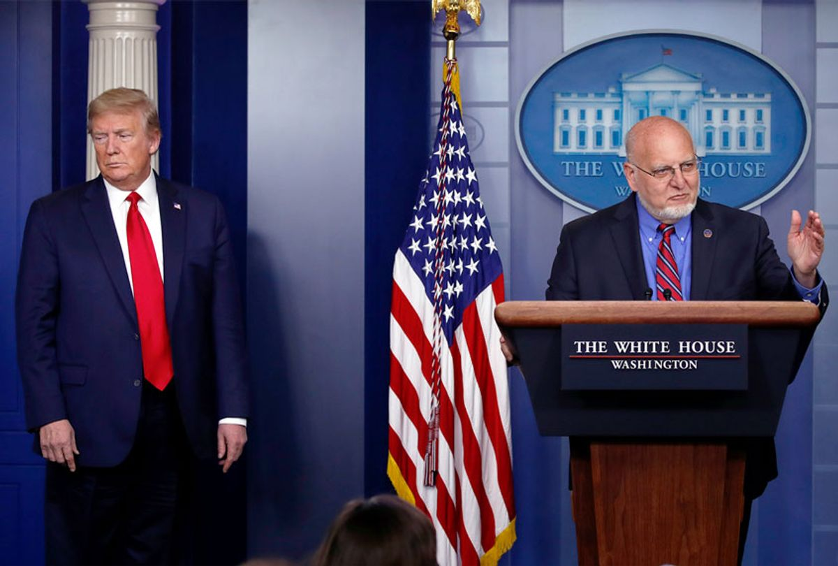 President Donald Trump listens as Dr. Robert Redfield, director of the Centers for Disease Control and Prevention, speaks about the coronavirus  (AP Photo/Alex Brandon)