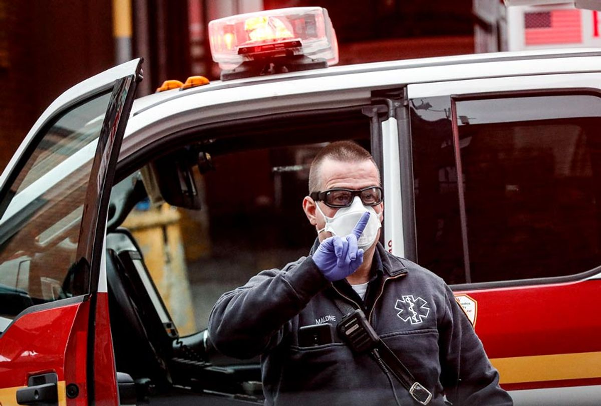 An FDNY medical worker wears personal protective equipment outside a COVID-19 testing site at Elmhurst Hospital Center (AP Photo/John Minchillo)