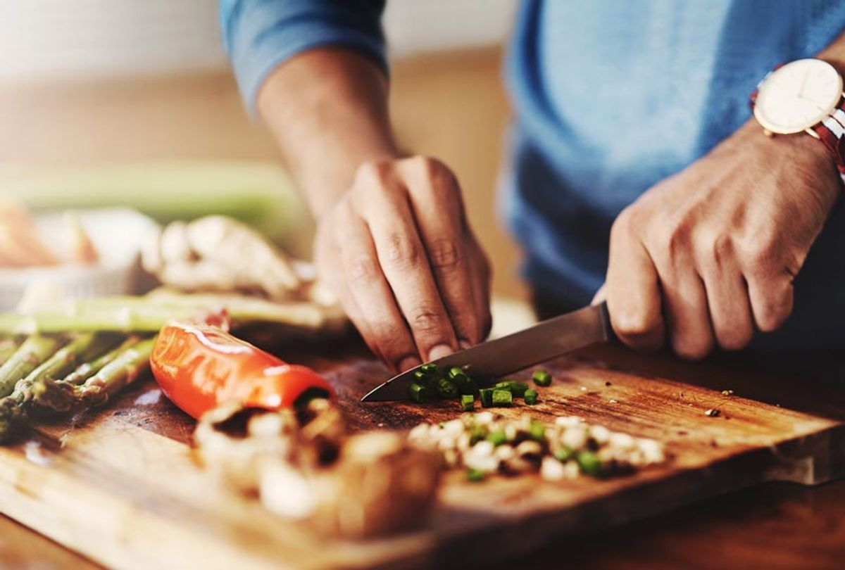 A man preparing a healthy meal at home (Getty Images)