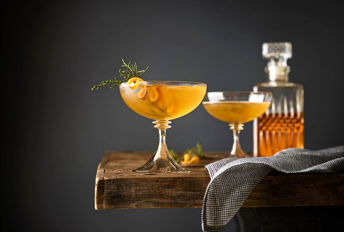 Manhattan cocktails garnished with Juniper on a table with whiskey decanter in the background. (Getty Images/Annabelle Breakey)