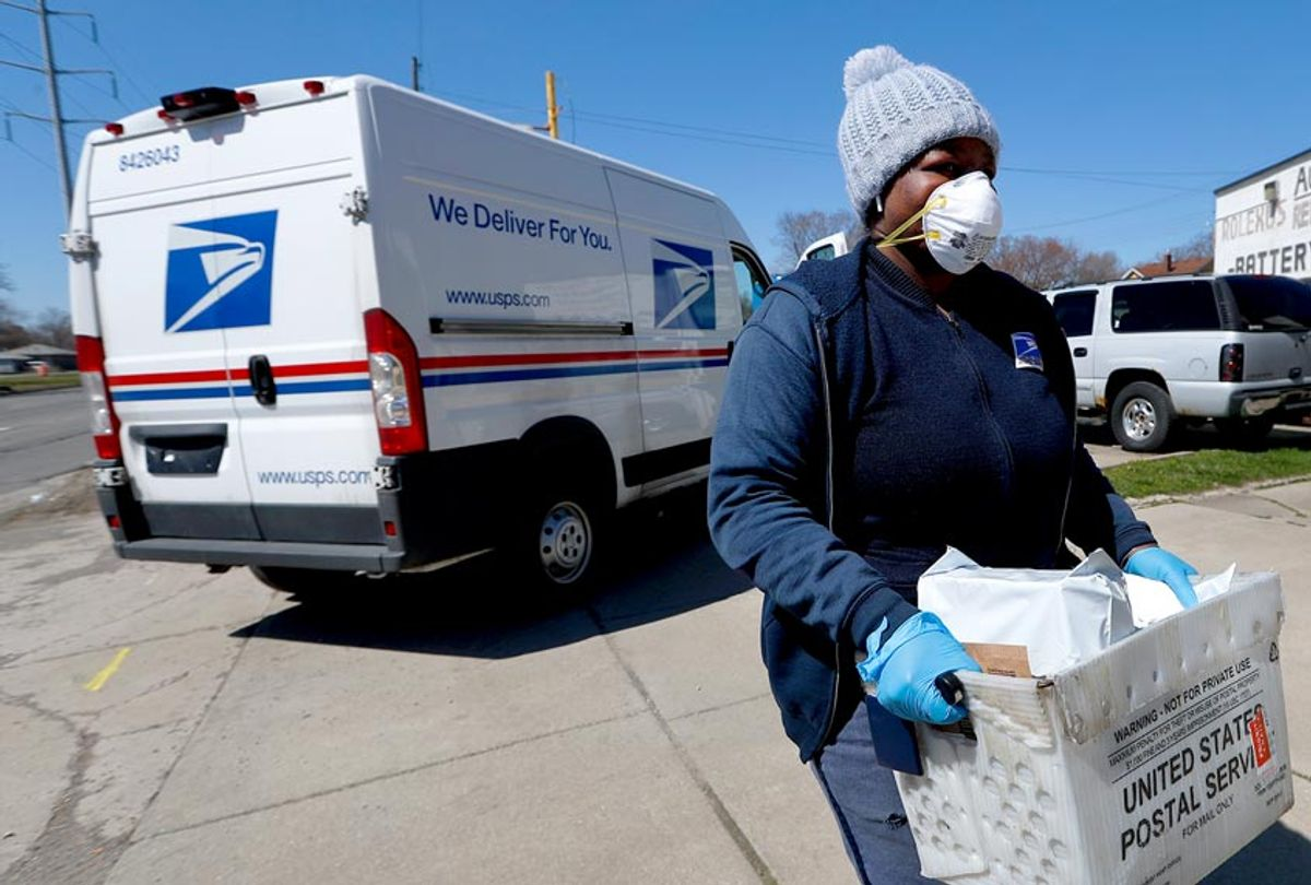A United States Postal worker makes a delivery with gloves and a mask (AP Photo/Paul Sancya)