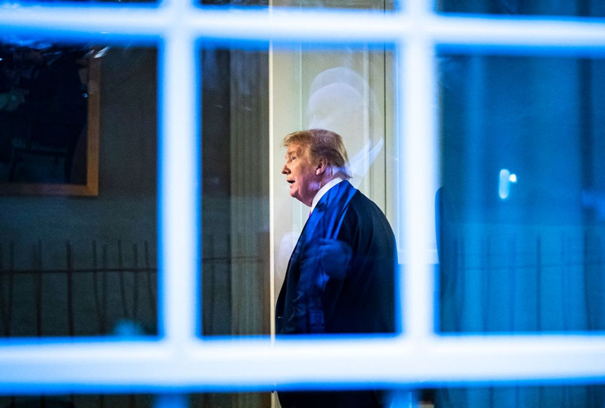 President Donald J. Trump, seen through a window, watches a television in the press office as newscasters talk about him moments after he was speaking with members of the coronavirus task force during a briefing in response to the COVID-19 coronavirus pandemic in the James S. Brady Press Briefing Room at the White House. (Jabin Botsford/The Washington Post via Getty Images)