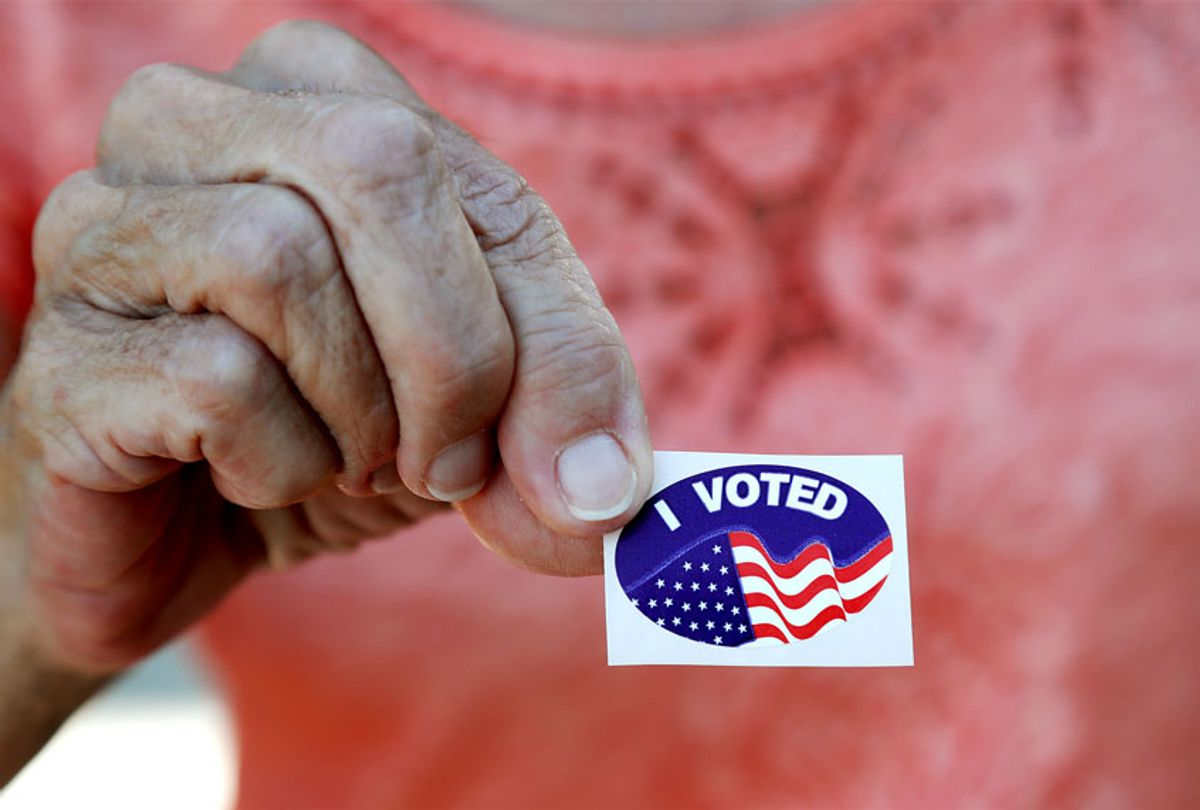 Woman shows her sticker after she voted in the Florida presidential primary in Cape Coral, Fla. (AP Photo/Elise Amendola)