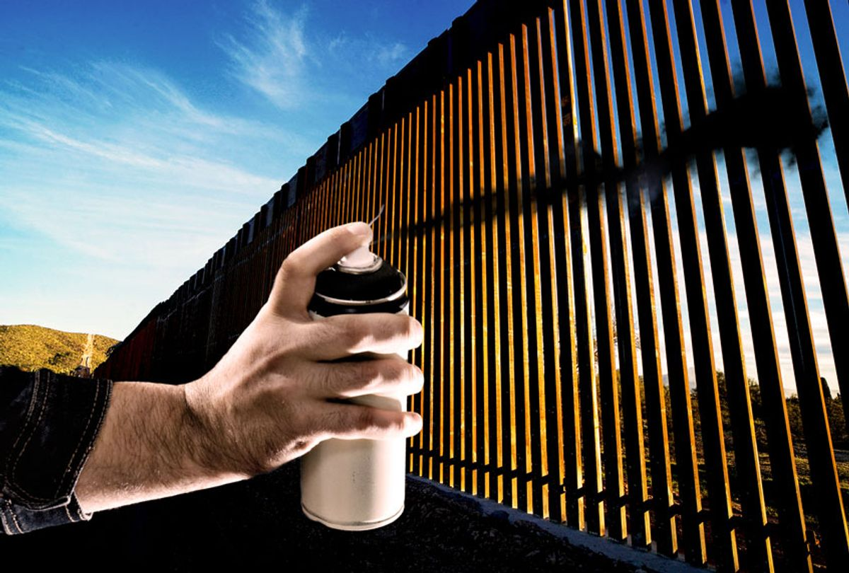 The United States-Mexico border wall spray painted black (Photo illustration by Salon/AFP/Getty Images)