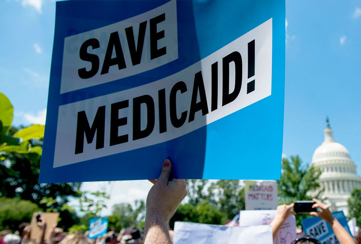 Participants hold signs during the Senate Democrats' rally against Medicaid cuts in front of the U.S. Capitol (Bill Clark/CQ Roll Call)