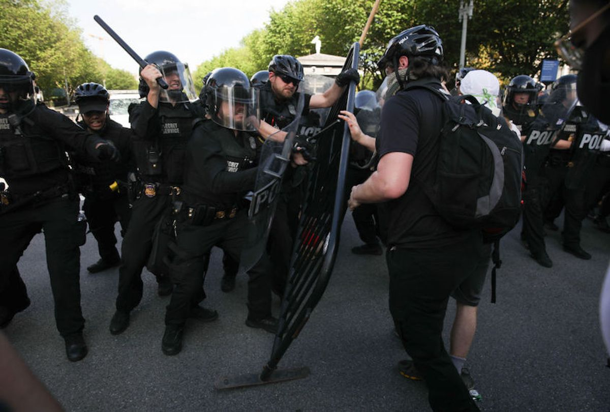 Demonstrators, gathered at Lafayette Park across from the White House, attempt to breach a police barricade during a protest over the death of George Floyd, an unarmed black man who died after being pinned down by a white police officer in Washington, United States on May 30, 2020.  (Yasin Ozturk/Anadolu Agency via Getty Images)