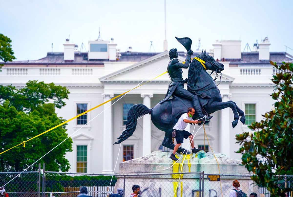 Protesters attempt to pull down the statue of Andrew Jackson in Lafayette Square near the White House on June 22, 2020 in Washington, DC. Protests continue around the country over police brutality, racial injustice and the deaths of African Americans while in police custody. (Drew Angerer/Getty Images)