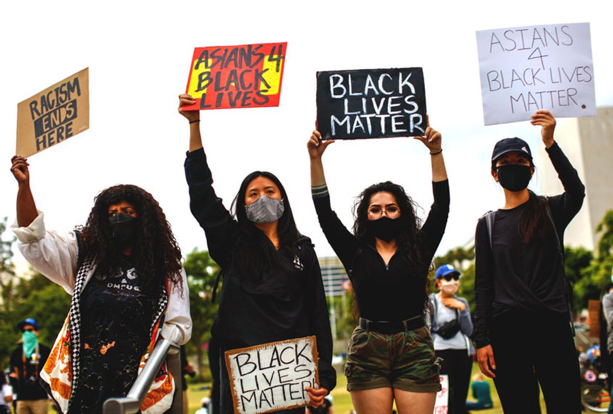 Friends, from left, Sheba Sahlemariam, from Los Angeles, Vicky Van, from San Gabriel, Raven Ramos, from Culver City and Jasmine chow, from San Gabriel, joined nearly 1,000 people gathered to protest the death of George Floyd and in support of Black Lives Matter, in downtown, Los Angeles, CA, on Friday, June 5, 2020. (Jay L. Clendenin / Los Angeles Times via Getty Images)
