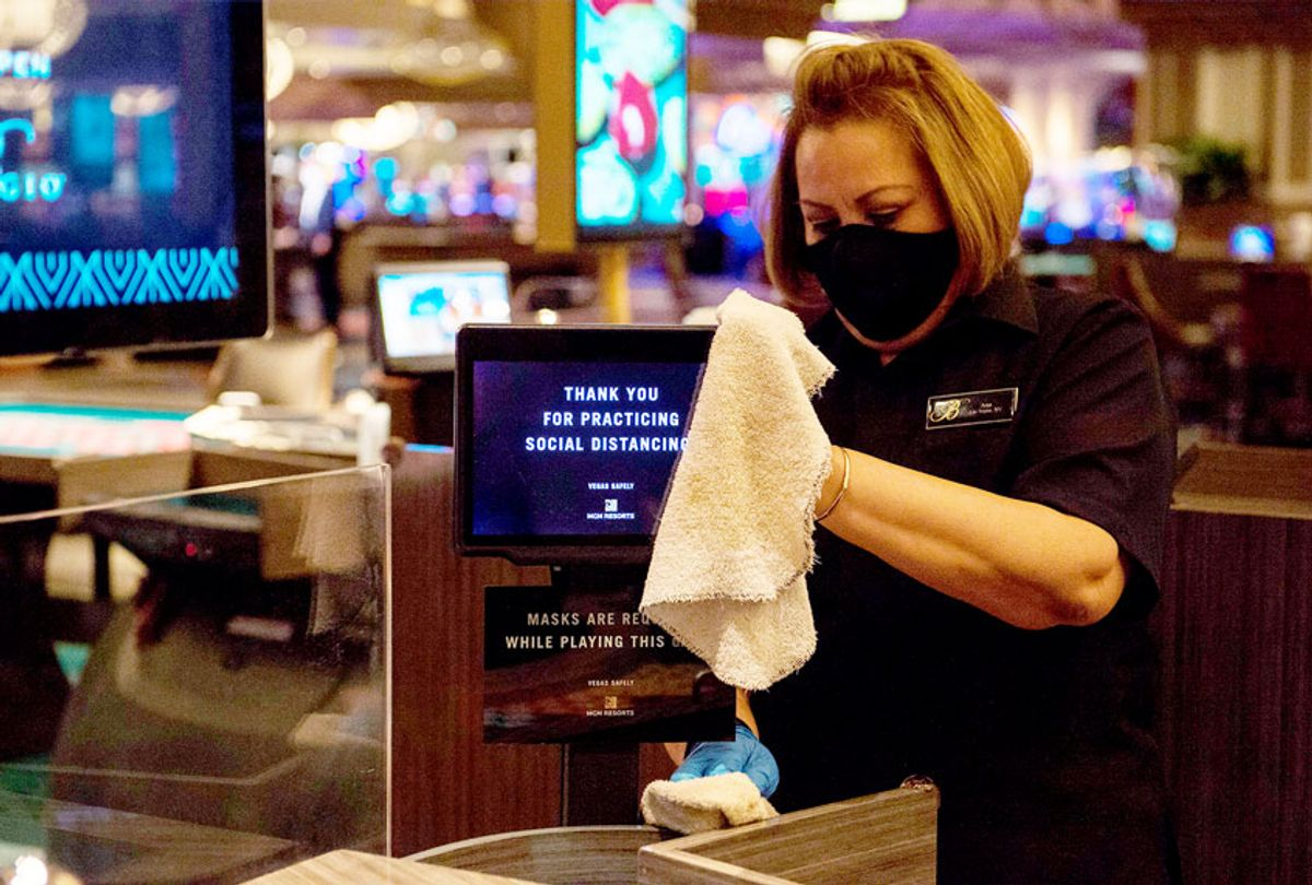 A casino employee cleans areas of the casino floor during a media tour of Bellagio hotel and casino reopening in Las Vegas, Nevada (BRIDGET BENNETT/AFP via Getty Images)