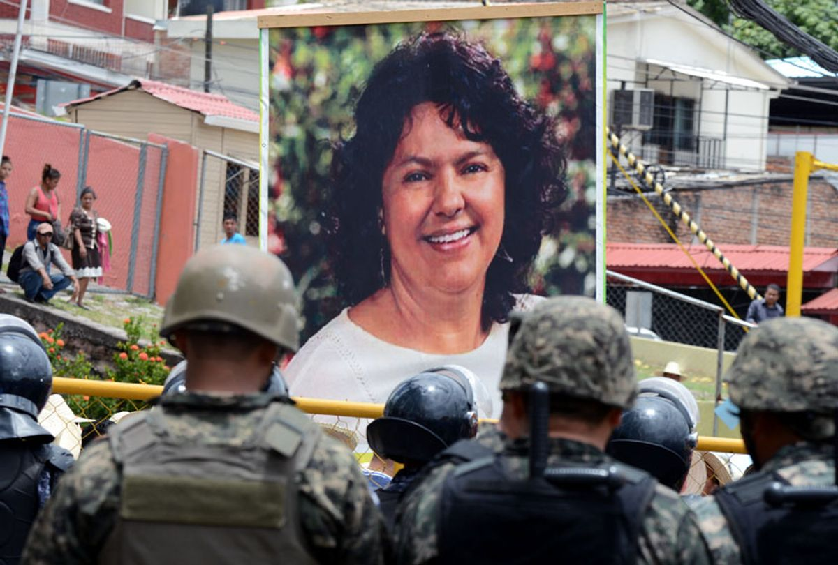 Hundreds of indigenous Hondurans and peasants march on August 17, 2016 in Tegucigalpa in Tegucigalpa demanding justice for the murder of indigenous environementalist Berta Caceres last July.  (ORLANDO SIERRA/AFP via Getty Images)