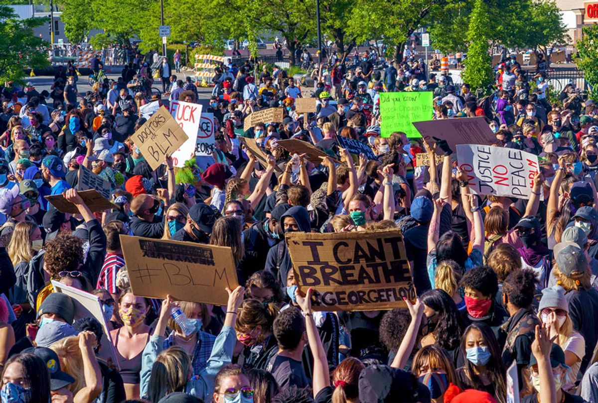 Protesters march during a demonstration in a call for justice for George Floyd who died while in custody of the Minneapolis police, on May 30, 2020 by the 5th police precinct in Minneapolis, Minnesota. (KEREM YUCEL/AFP via Getty Images)