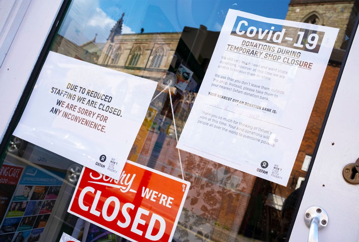 Store closed, with signs about COVID-19 (Mike Kemp/In PIctures via Getty Images)