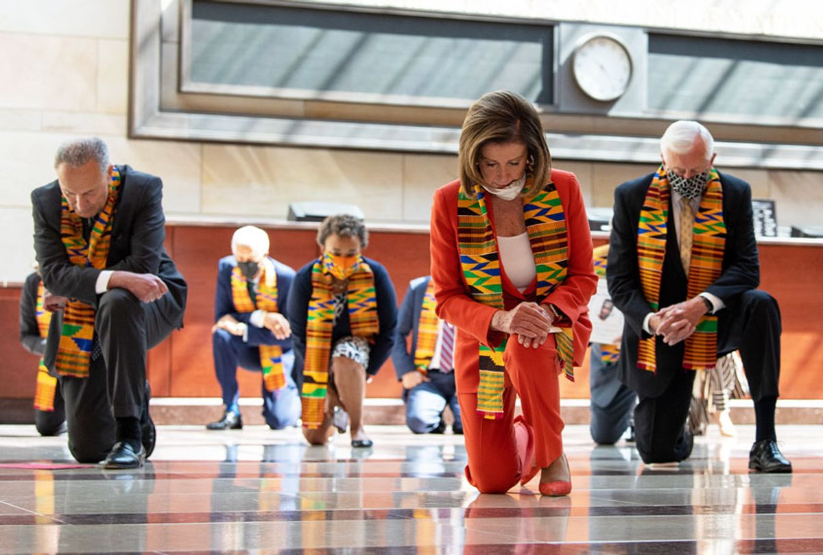 Speaker of the House Nancy Pelosi, D-Calif., and other members of Congress gather at the Emancipation Hall, kneel as they take moment of silence to honor George Floyd, and victims of racial injustice on Monday, June 8, 2020. (Caroline Brehman/CQ-Roll Call, Inc via Getty Image)
