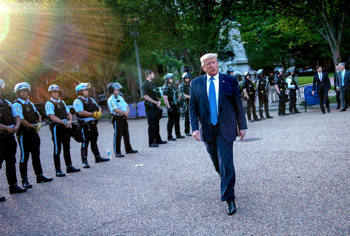 US President Donald Trump leaves the White House on foot to go to St John's Episcopal church across Lafayette Park in Washington, DC on June 1, 2020 (BRENDAN SMIALOWSKI/AFP via Getty Images)