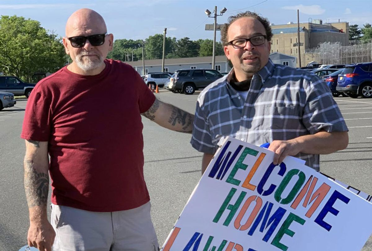 Lawrence Bell [right], moments after being released from East Jersey State Prison on Sunday, is greeted by his friend Ron Pierce [left], who was also incarcerated for three decades. (Photo taken by Chris Hedges)