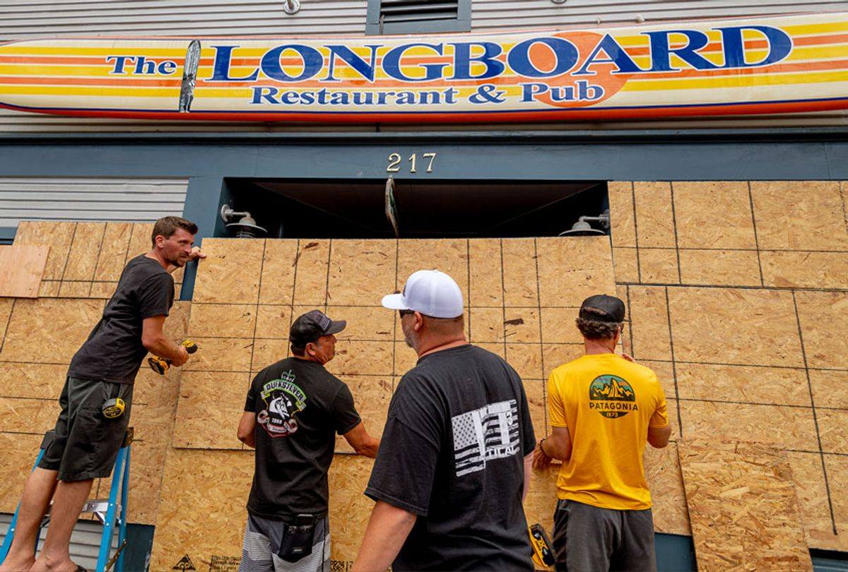 As a precaution in the event of a riot, the Longboard Restaurant & Pub is boarded up prior to a large protest (Getty Images)