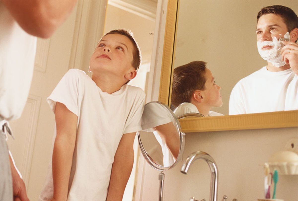 Boy Watching Father Shaving (Getty Images)