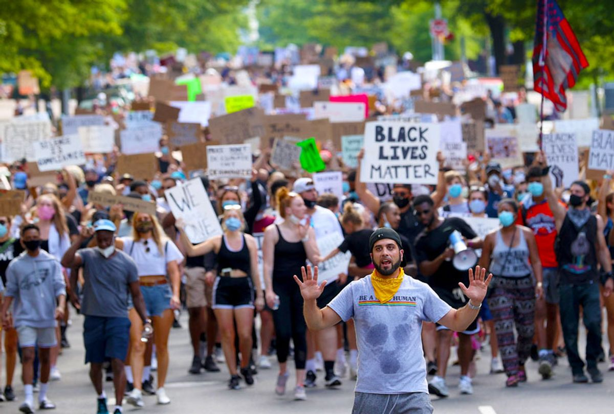 Demonstrators march to protest against police brutality and the death of George Floyd, in Virginia (Win McNamee/Getty Images)