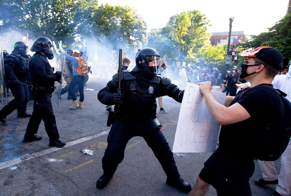 Police officers clash with protestors near the White House on June 1, 2020 as demonstrations against George Floyd's death continue. - Police fired tear gas outside the White House late Sunday as anti-racism protestors again took to the streets to voice fury at police brutality. (Getty Images)