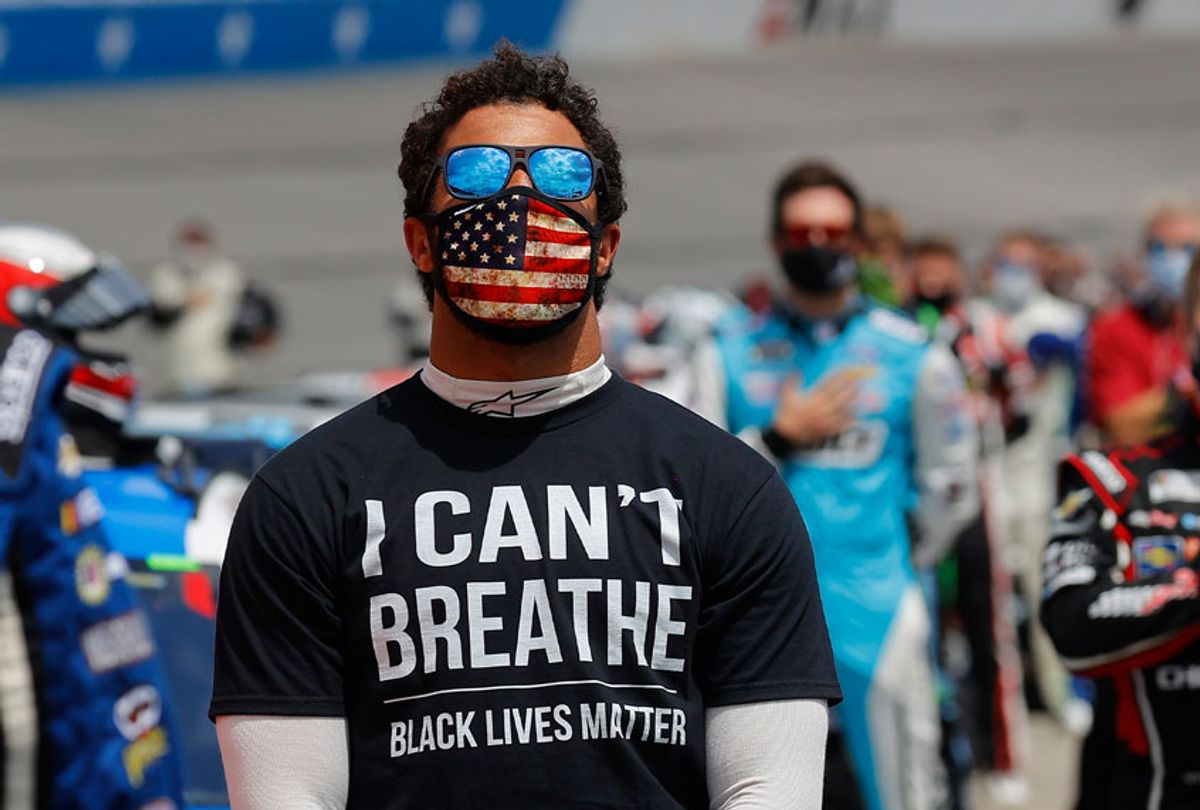 """Bubba Wallace, driver of the #43 McDonald's Chevrolet, wears a """"I Can't Breathe - Black Lives Matter"""" T-shirt under his fire suit in solidarity with protesters around the world taking to the streets after the death of George Floyd while in police custody. (Chris Graythen/Getty Images)"""