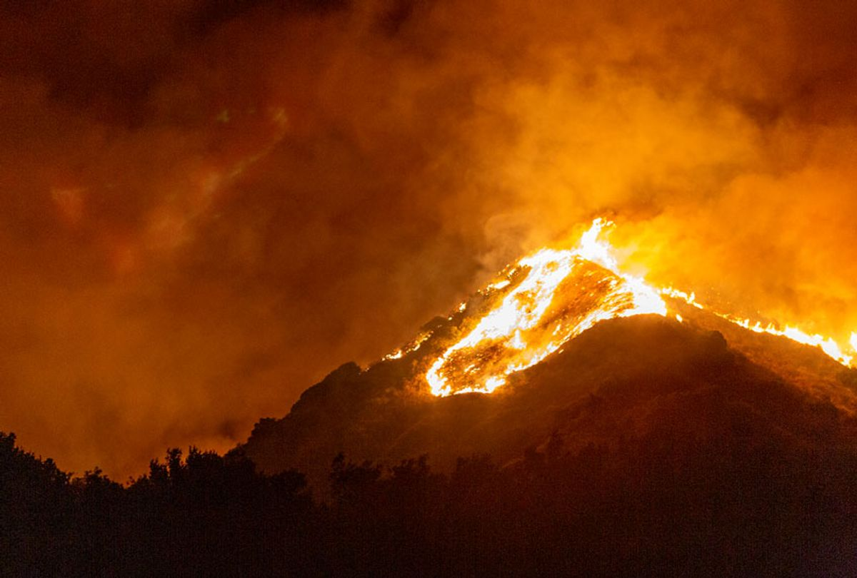 he Maria Fire burns on a hillside as it expands up to 8,000 acres on its first night on November 1, 2019 near Somis, California. (David McNew/Getty Images)