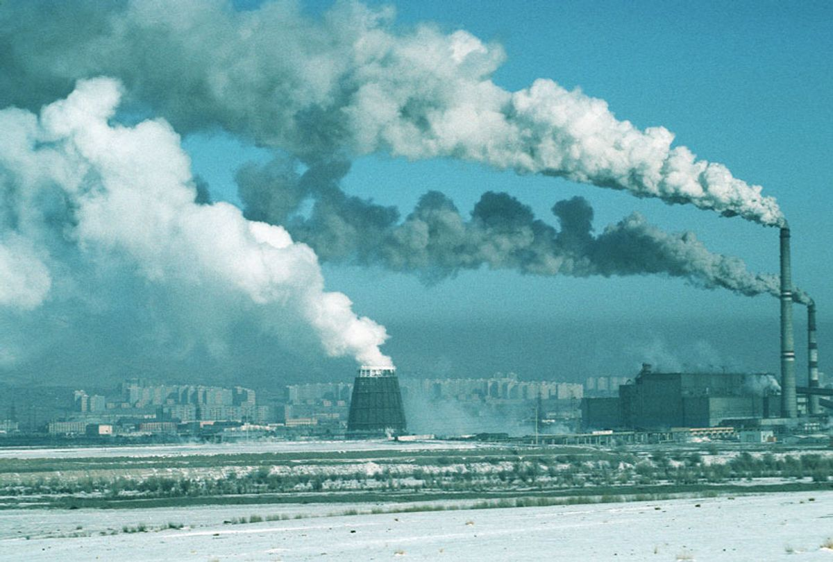 Factory chimneys spewing smoke and pollution into the atmosphere on the outskirts of Ulan Bator (Peter Charlesworth/LightRocket via Getty Images)