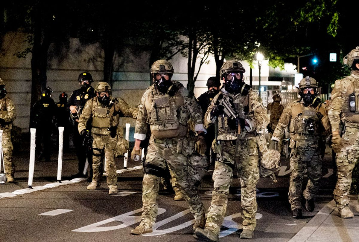 Federal officers prepare to disperse the crowd of protestors outside the Multnomah County Justice Center on July 17, 2020 in Portland, Oregon. Federal law enforcement agencies attempt to intervene as protests continue in Portland. (Mason Trinca/Getty Images)