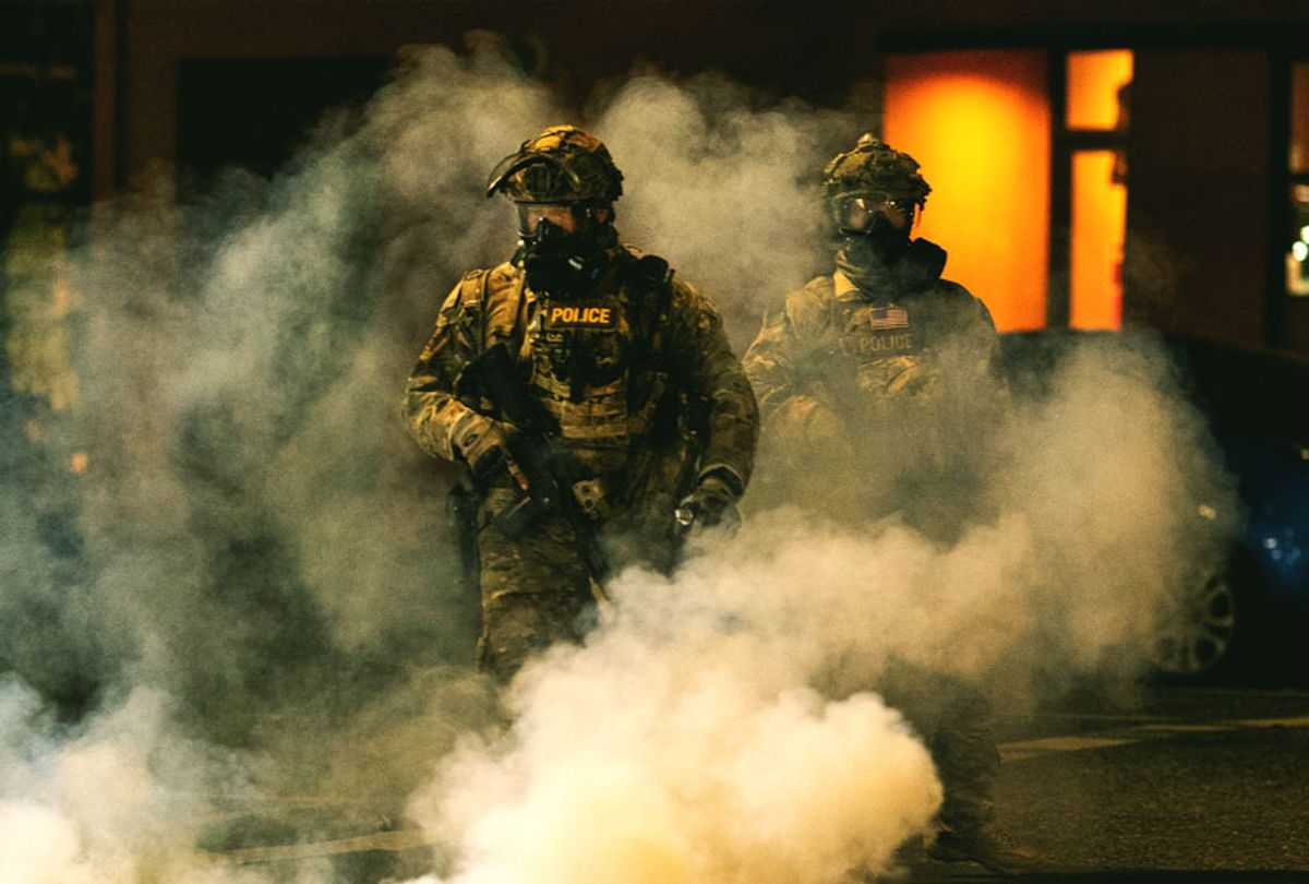 Federal officers operate amid tear gas while clearing the street in front of the Mark O. Hatfield U.S. Courthouse on July 21, 2020 in Portland, Oregon. The federal police response to the ongoing protests against racial inequality has been criticized by city and state elected officials as President Trump threatens to use Federal law enforcement in other major cities as well. (Paula Bronstein/Getty Images)