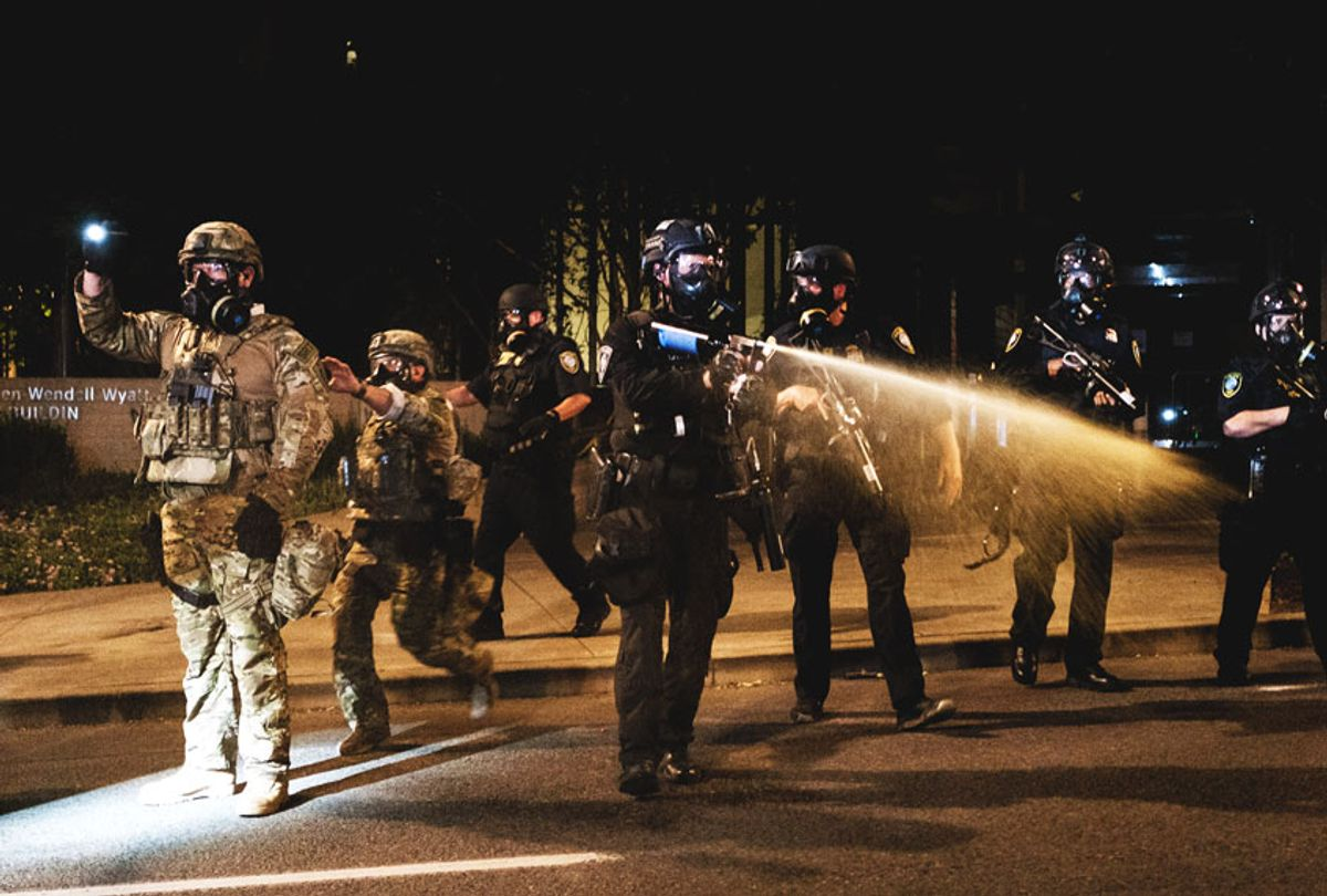 Federal officers use tear gas and other crowd dispersal munitions on protesters outside the Multnomah County Justice Center on July 17, 2020 in Portland, Oregon. Federal law enforcement agencies attempt to intervene as protests continue in Portland. (Mason Trinca/Getty Images)