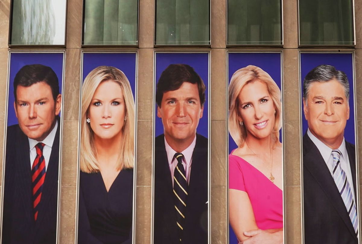 Advertisements featuring Fox News personalities, including Bret Baier, Martha MacCallum, Tucker Carlson, Laura Ingraham, and Sean Hannity, adorn the front of the News Corporation building, (Getty Images/Drew Angerer/Getty Images)