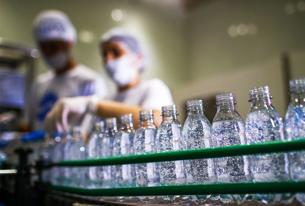 Workers in the hand sanitizer bottling process in AGE do Brasil factory on April 6, 2020, in Vinhedo, Brazil. (Buda Mendes/Getty Images)