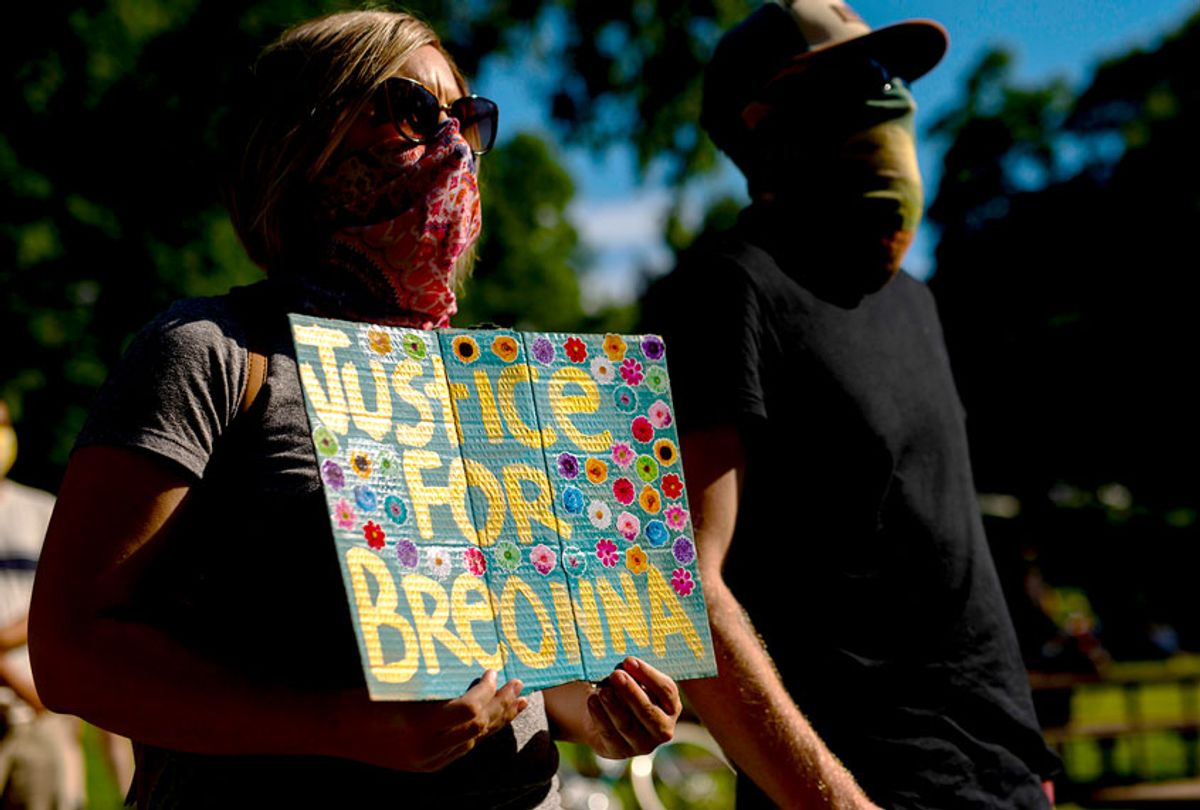 People gather in Powderhorn Park before a march honoring Breonna Taylor on June 26, 2020 in Minneapolis, Minnesota. Taylor was shot and killed by members of the Louisville Metro Police Department on March 13, 2020. (Stephen Maturen/Getty Images)