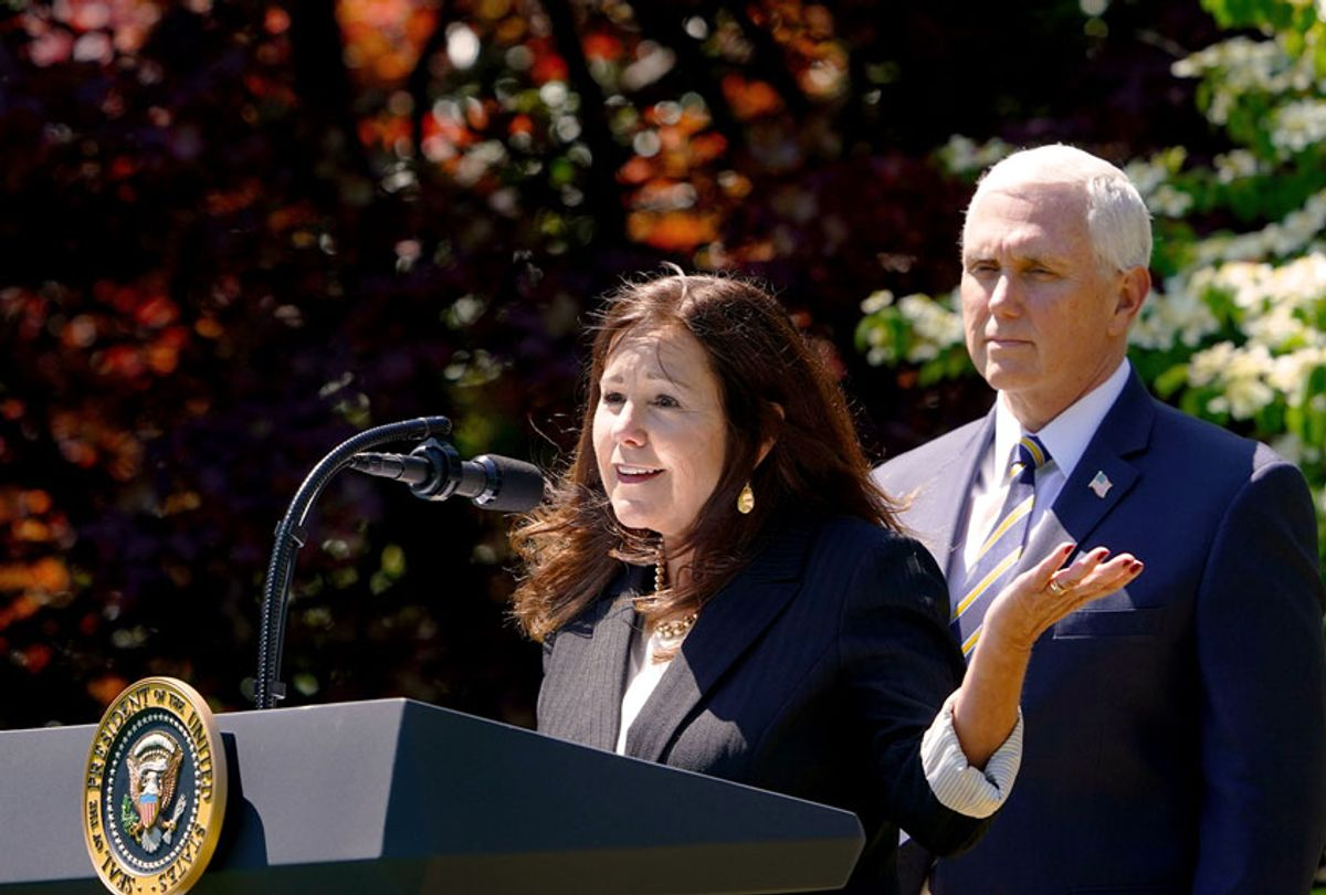 Vice President Mike Pence listens as his wife Karen Pence (MANDEL NGAN/AFP via Getty Images)