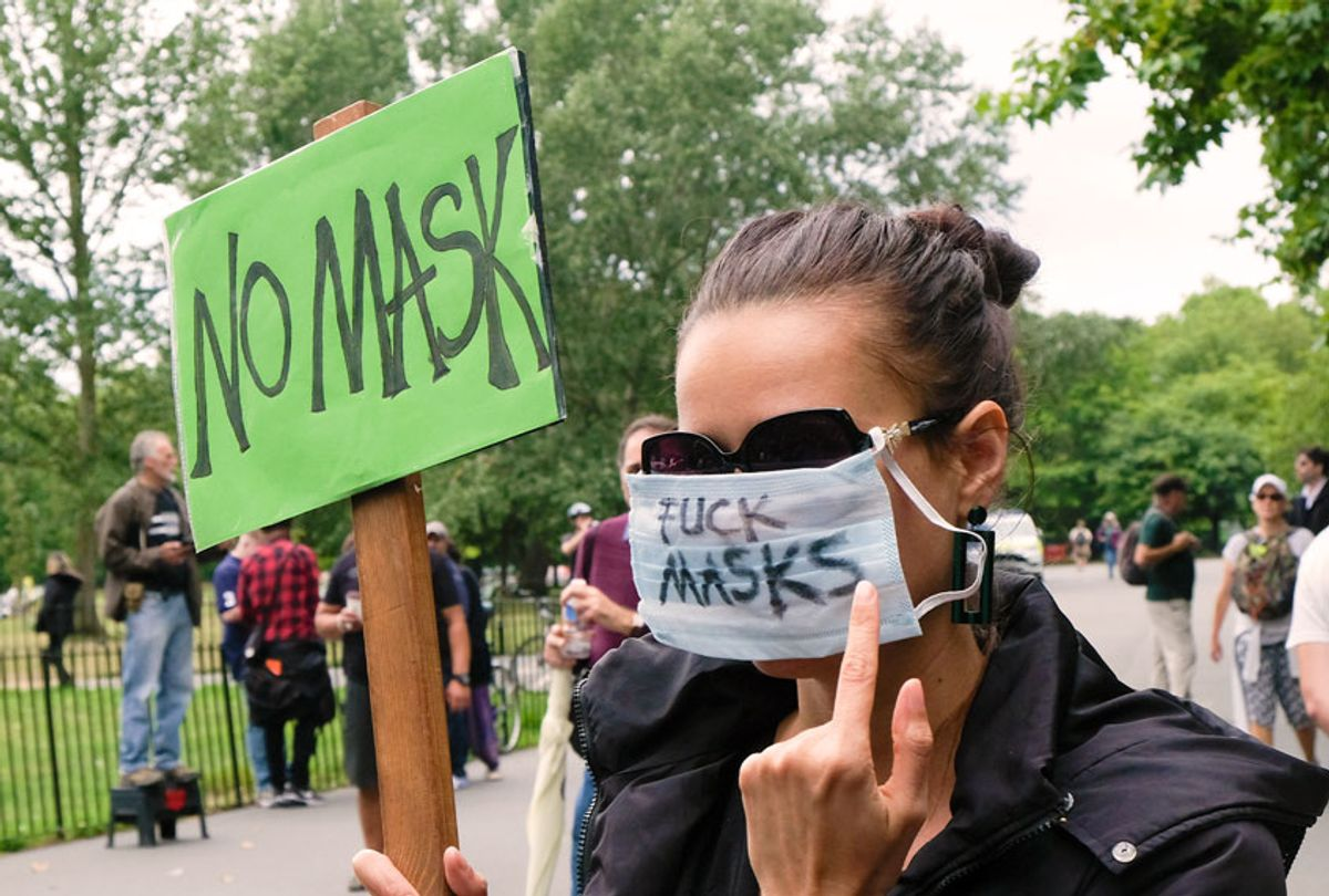 Woman protesting against the imposition of the wearing of masks (Matthew Chattle/Barcroft Media via Getty Images)