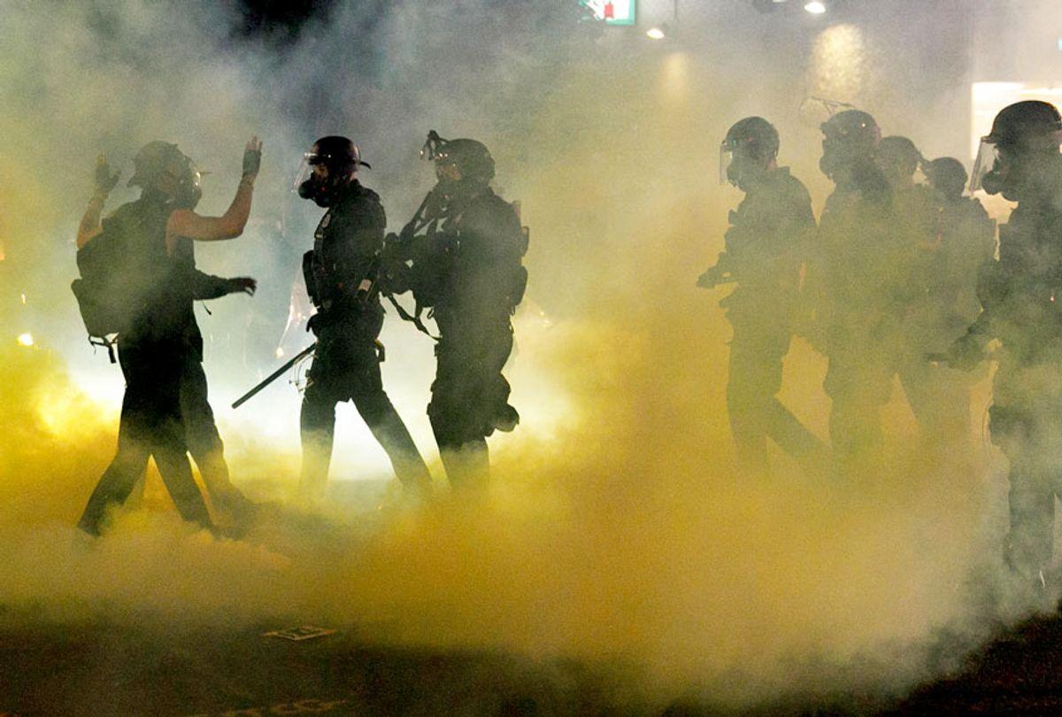 Police confront Black Lives Matter demonstrators in Portland, Oregon. (John Rudoff/Anadolu Agency via Getty Images)