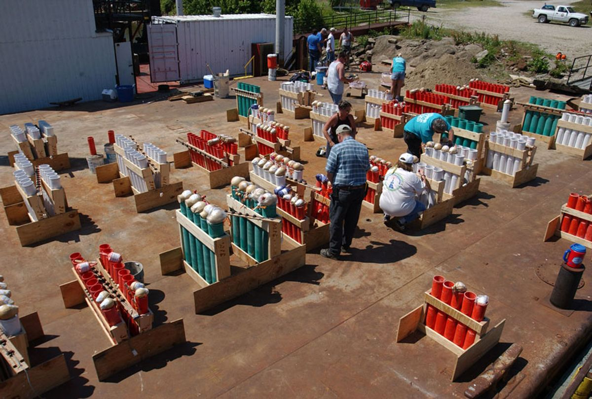 Pyrotechnicians prepare for a 4th of July fireworks show (David Greedy/Getty Images)