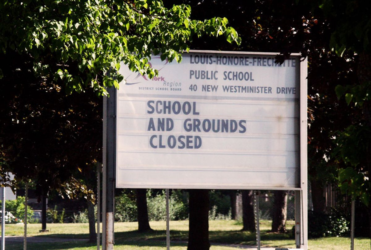 Sign outside a closed school during the novel coronavirus (COVID-19) (Creative Touch Imaging Ltd./NurPhoto via Getty Images)