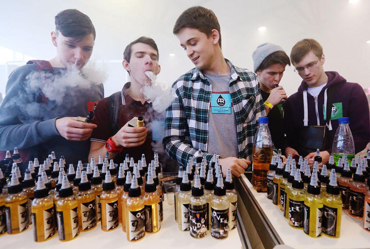 Teenagers smoking electronic cigarettes (Sergei Konkov\TASS via Getty Images)