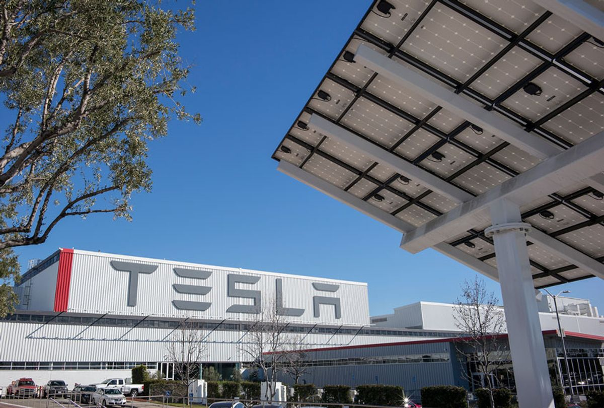cenes at the Tesla car factory include the building's exterior with a solar panel on the property (right of frame). (David Butow/Corbis via Getty Image)