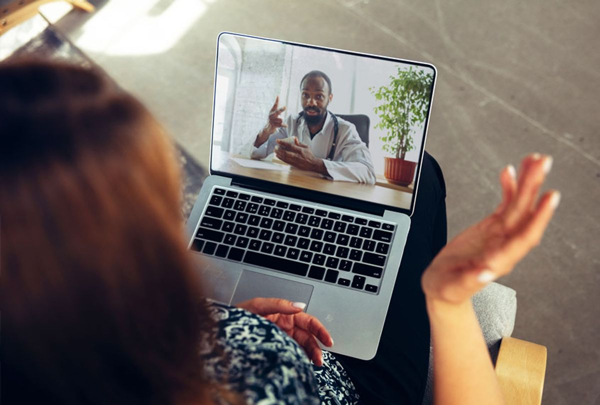 Close up of young woman getting online medical help and advice during videocall with doctor (Getty Images)
