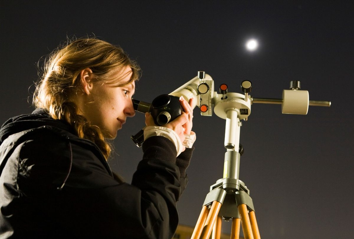 Young amateur astronomer on a school yard in Lichtenberg watching the moon with a telescope (Rolf Schulten/ullstein bild via Getty Images)