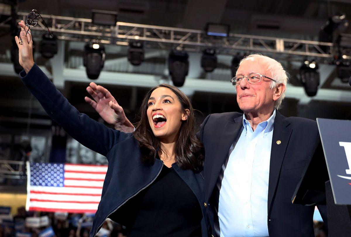 U.S. Rep. Alexandria Ocasio-Cortez (D-N.Y) and Democratic presidential candidate Sen. Bernie Sanders (I-VT) (Joe Raedle/Getty Images)