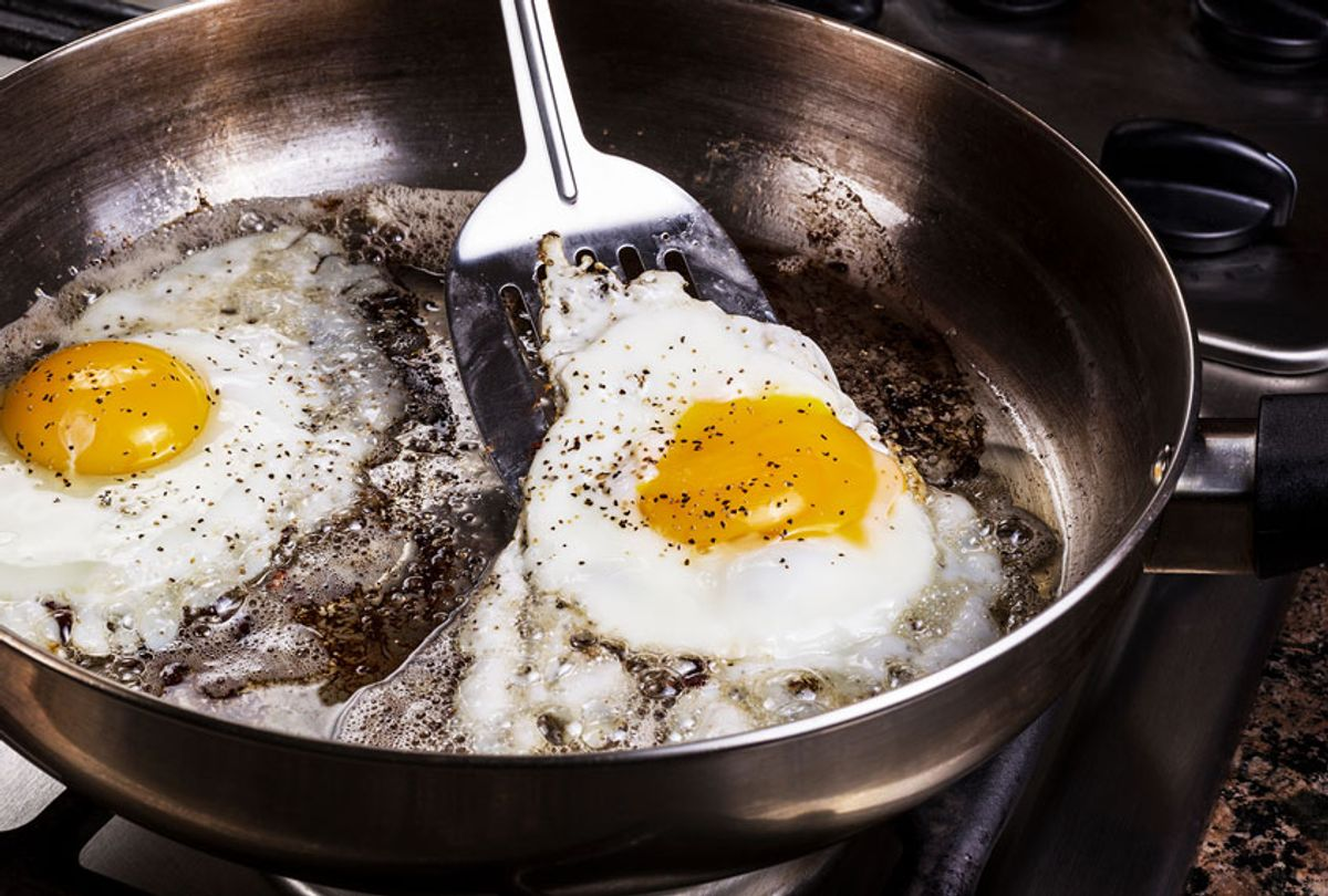 Fried Eggs In Cooking Pan On Stove (Getty Images/Tom Baker)