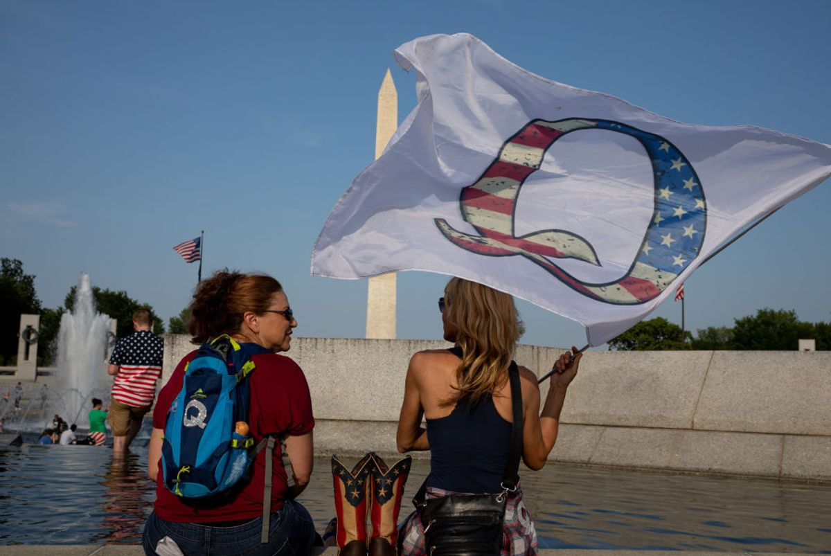 QAnon supporters wait for the military flyover at the World War II Memorial during Fourth of July celebrations in Washington, D.C. (Evelyn Hockstein/The Washington Post via Getty Images)